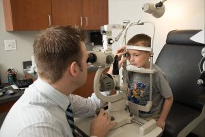Optometrist, little boy getting eyes checked in Kelowna, BC
