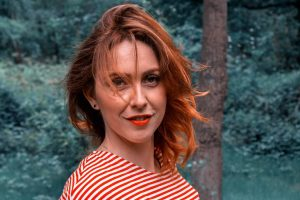 red head woman striped shirt in Saginaw and Hemlock, MI