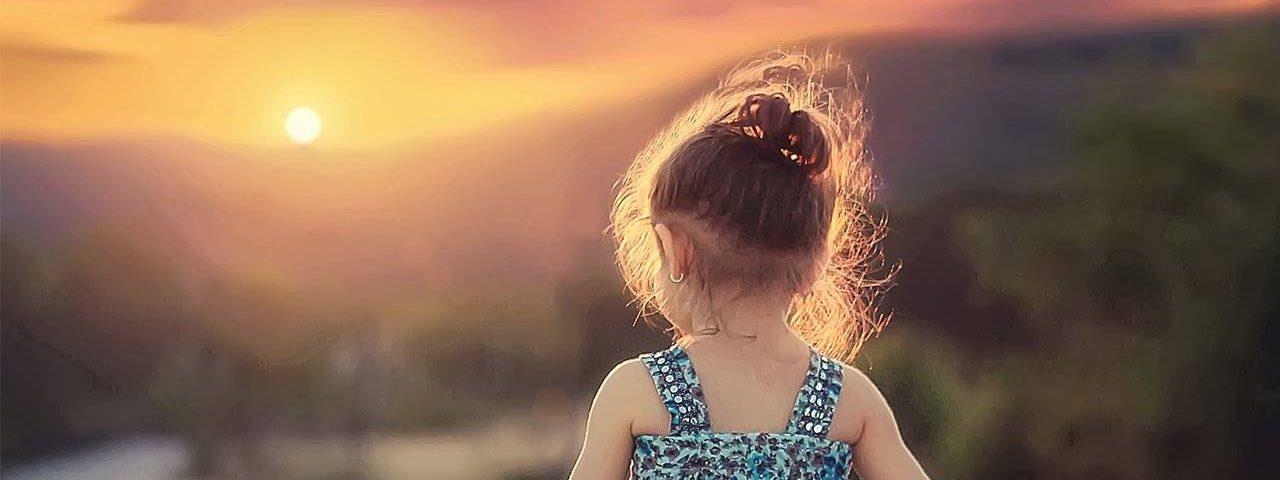 little girl walking during sunset