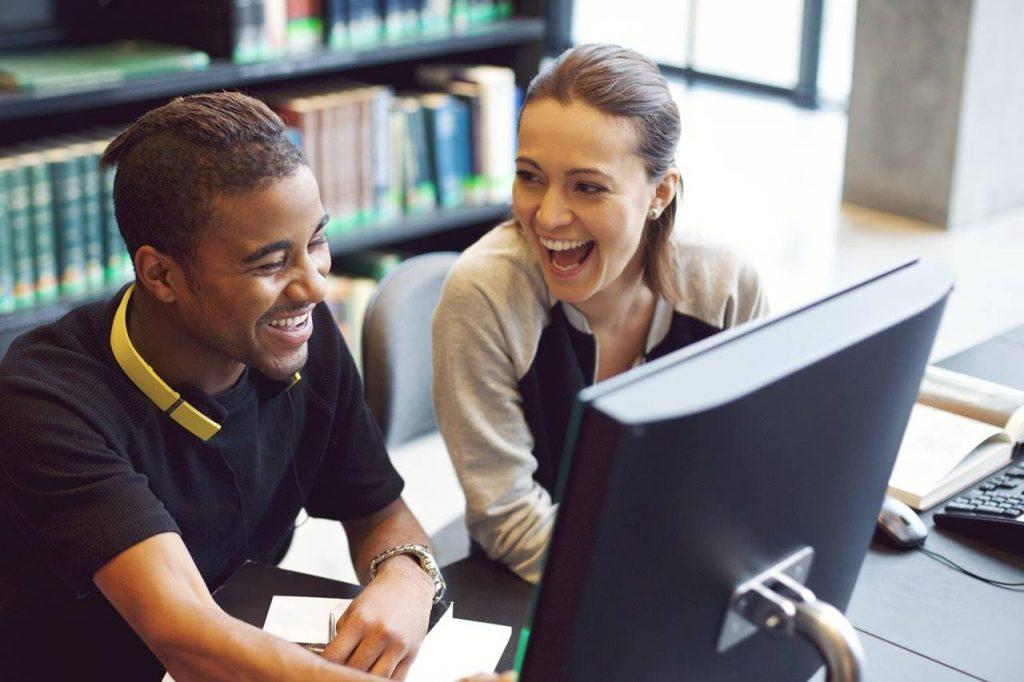 man and woman looking at computer paramus nj