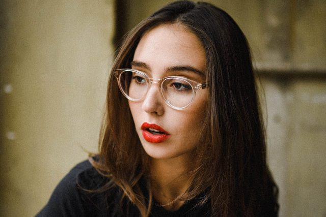 woman clear frames red lips 1280x853
