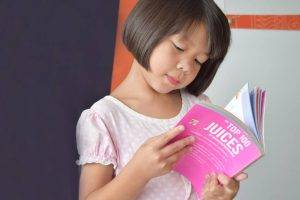 Asian Girl Reading Book - Eye Doctor - Plano, TX