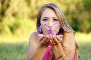 Female Blowing Purple Flowers