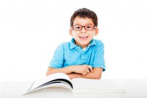 boy glasses reading hispanic