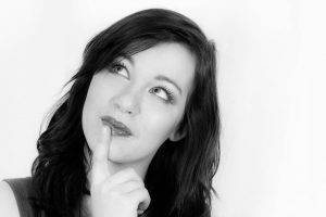 female thinking black and white