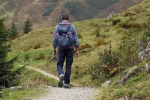 man hiking trail backpack