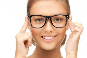 woman wearing black glasses