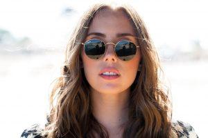 Eye Care,Young Woman Wearing Sunglasses in Irvine&Laguna Beach ,CA