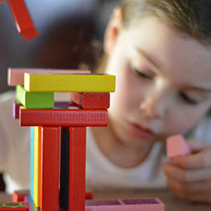 girl playing with blocks in Whitby | vision therapy
