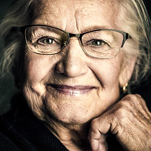 senior woman in Binghamton elegant glasses smiling