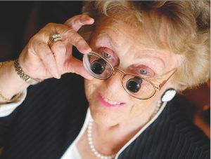 Eye doctor, senior woman wearing low vision eyeglasses in Lancaster, OH