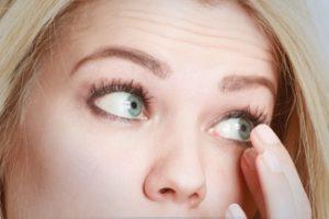 eye exam, woman wearing contact lens in Burnsville, MN