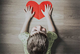 child with heart cutout at Whitby Vision Care