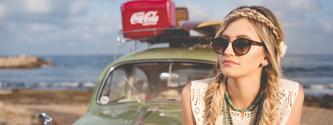 girl car sunglasses braids