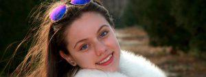 girl sunglasses on head smiling