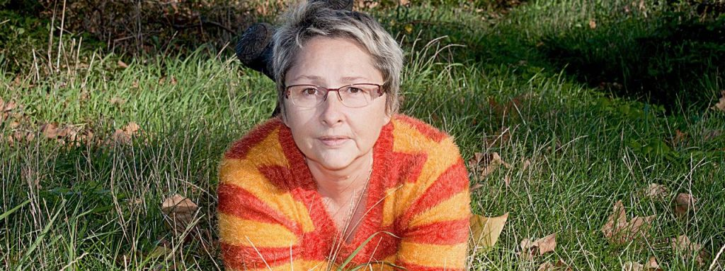 older woman glasses grass - Co Management of Cataracts and Lasik surgery in Columbus, Ohio