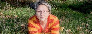 older woman glasses grass