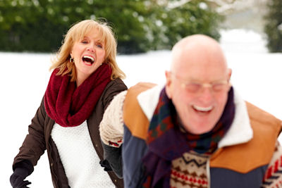 senior couple in the snow