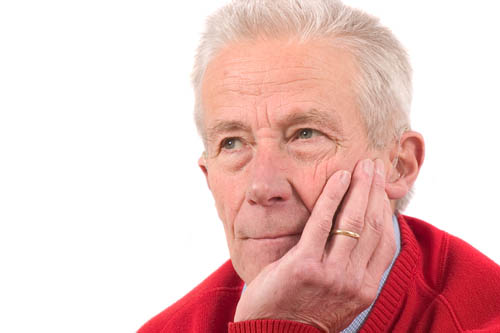 elderly man with cataracts looking into distance