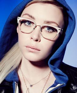 Chrome Hearts ad with woman wearing glasses and blue scarf 250×300