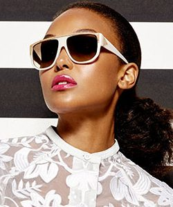 LAMB Ad with African American woman wearing white lace and white sunglasses