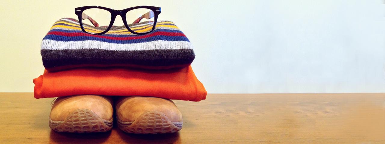 eyeglasses resting on folded towels