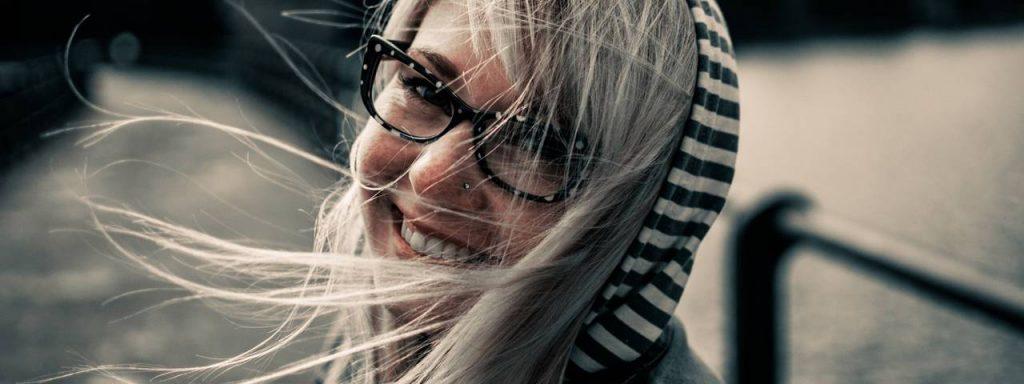 Woman with eyeglasses, wind in hair