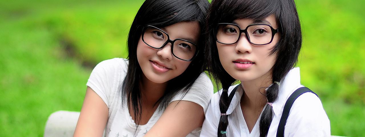 Girls wearing glasses sitting outside in Charlotte, North Carolina