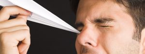 Man Poking Eye Paper Airplane