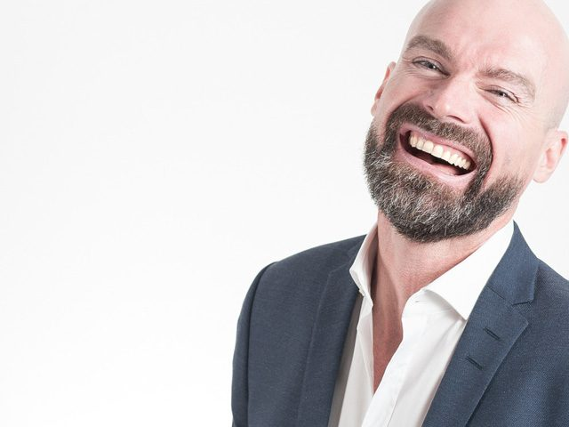 bearded-business-man-laughing