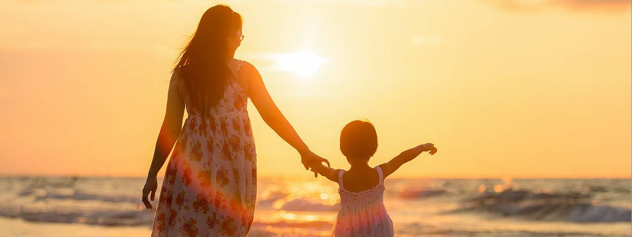 Mom-Child-Holding-Hands-Beach-Sunset-1280x480