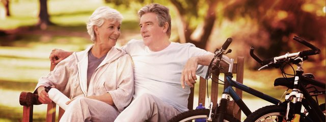 Older Couple Bench Bikes presbyopia the woodlands tx