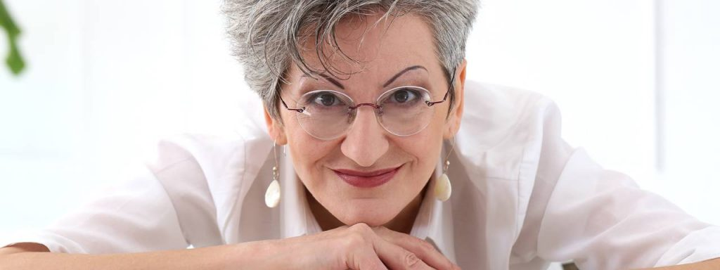 Older Woman Smiling Eyeglasses in Sherwood Park Alberta