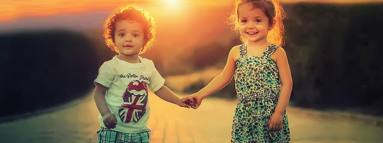 children_holding_hands_glowing_sun_1280x480