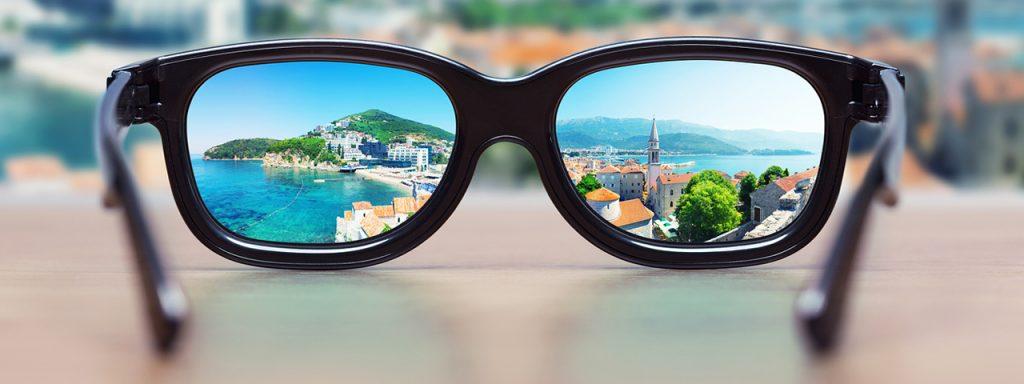 cityscape focused in glasses 1280x480