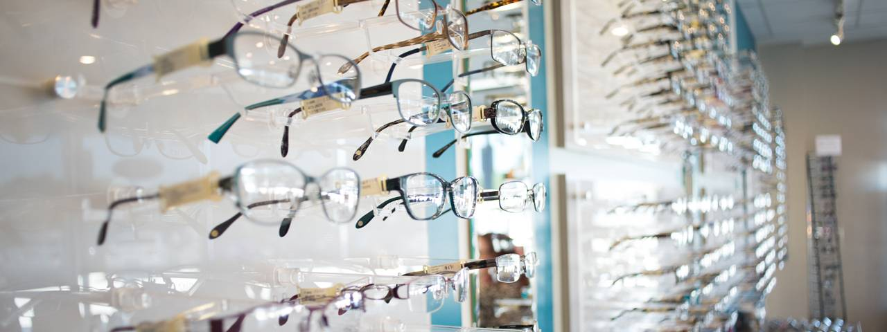 closeup of glasses display wall 1280x480