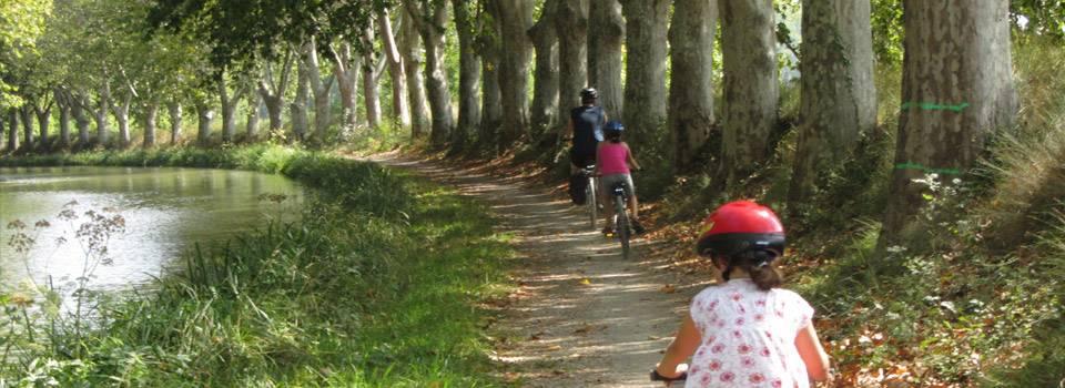 family riding bikes along path -Eye Exam & Family Eye Care in Grand Prairie, Texas