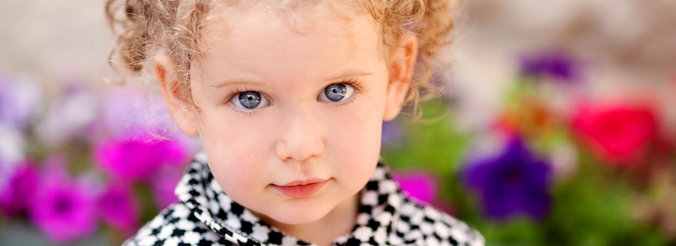 girl%20with%20blue%20eyes%20in%20black%20and%20white%20coat%20slide.png