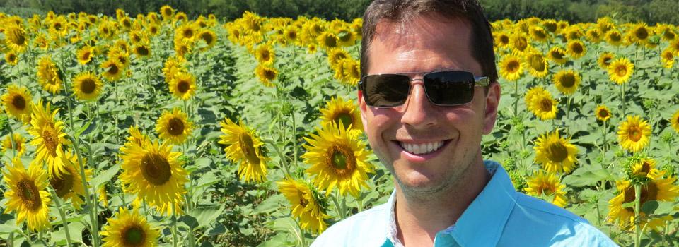 man in sunglasses surround by flowers, - Eye Doctor - Austin & Round Rock, TX