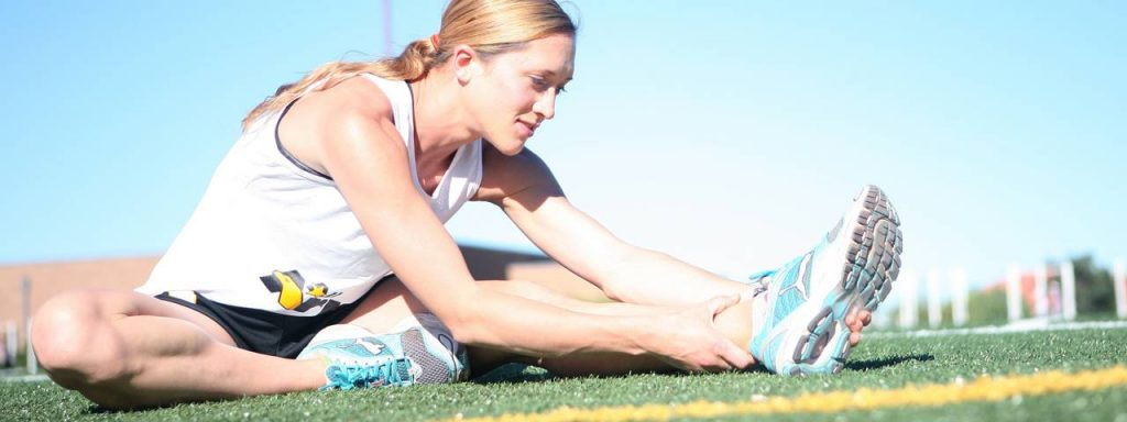 sports female runner stretching 1280x480
