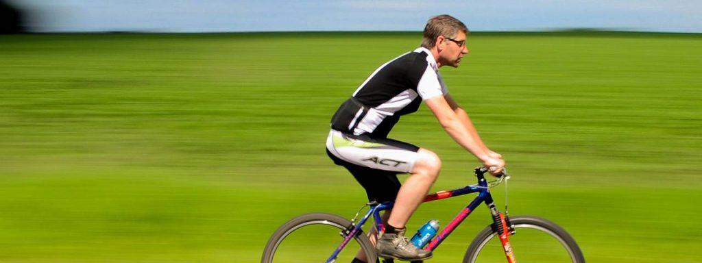 sports male cyclist roadbike wearing sunglasses in Fort Myers, FL