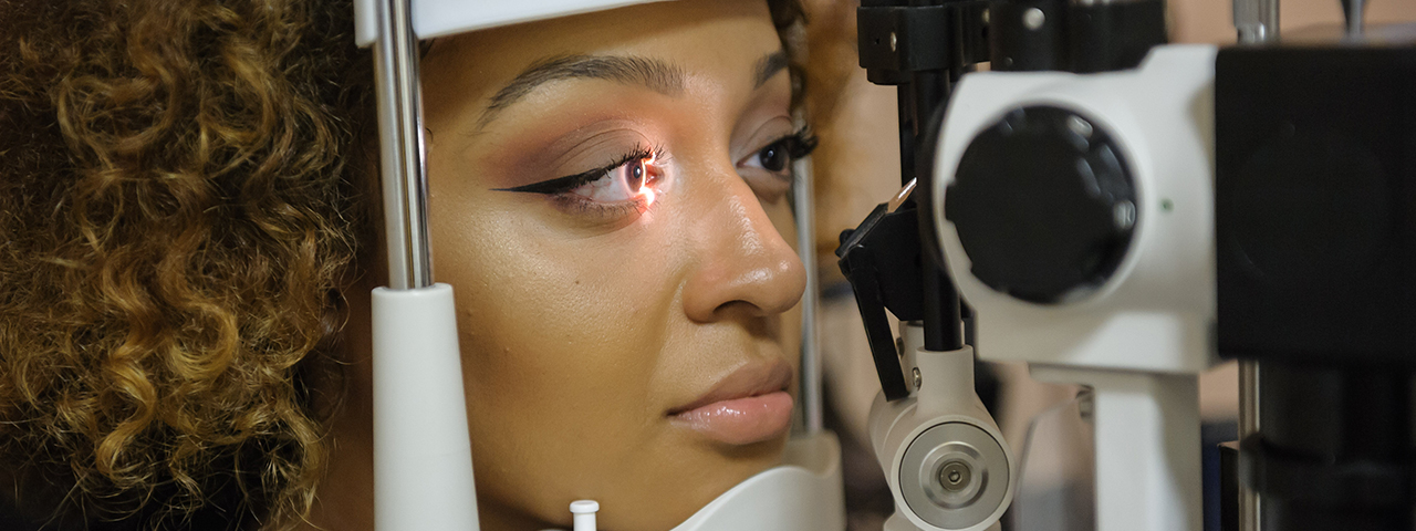 Woman having slit light test during eye exam