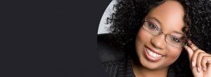 smiling black woman wearing eyeglasses | How Serious is a Black Eye?