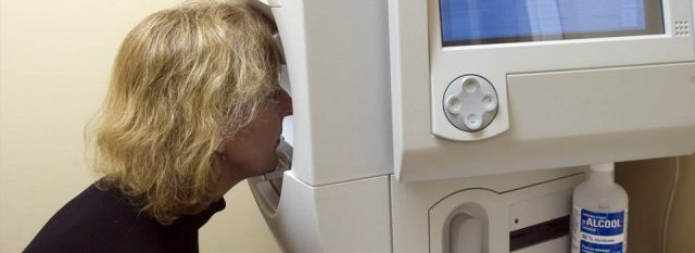 woman using visual field test, optometrist, Fort Worth, TX