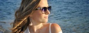 woman near ocean wearing sunglasses, optometrist, Lantana, FL