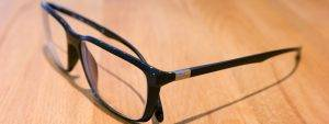Black Frames Brown Desk - eyeglasses in Lake Mary & Orlando, FL