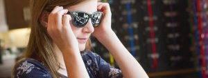 teenage girl trying on sunglasses in Kelowna, BC