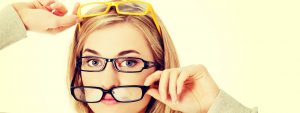 Woman trying on eyeglasses in Cranbrook BC