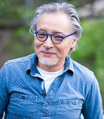 asian man blue glasses smile r