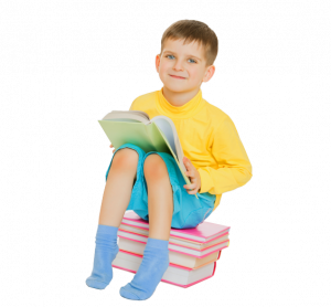 Boy sitting on book | pediatric eye exam san jose ca